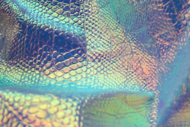 Streszczenie modny wąż holograficzny tło z neonowymi kolorami. tło dla swojego projektu.
