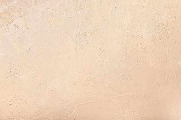 Streszczenie neutralny beżowy mur. teksturowane tło. selektywna ostrość.