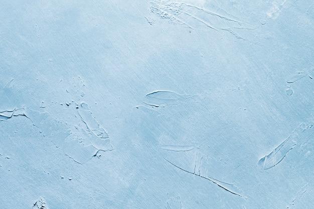 Streszczenie niebieskim tle szorstkiej teksturowanej