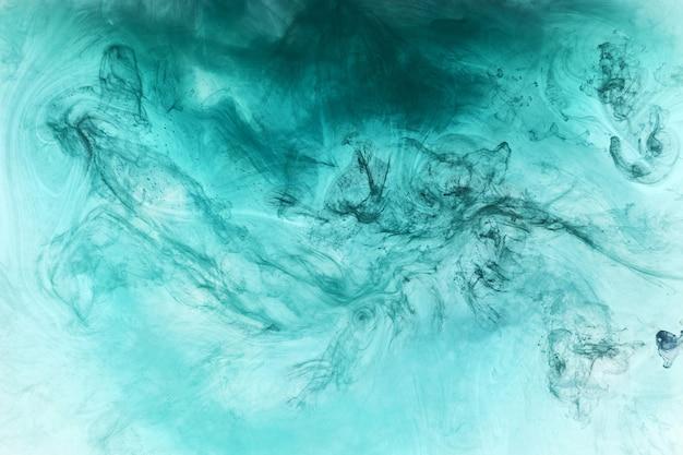 Streszczenie niebiesko zielony ocean, farba w tle wody. wir rozprysków i fal w ruchu. płynna tapeta artystyczna, płynne żywe kolory