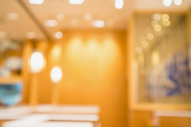 Streszczenie niewyraźne kawiarnia z bokeh świateł niewyraźne tło