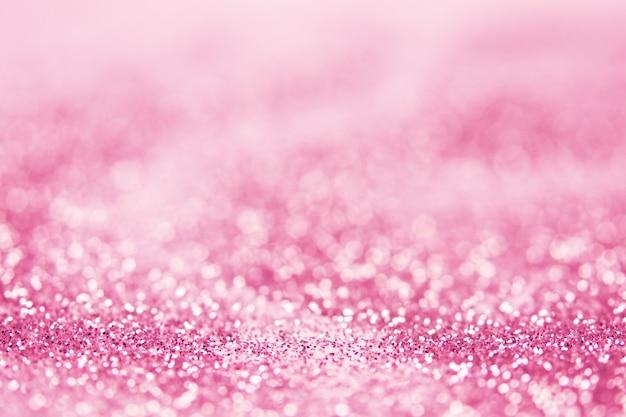 Streszczenie niewyraźne musujące różowe tło bokeh.