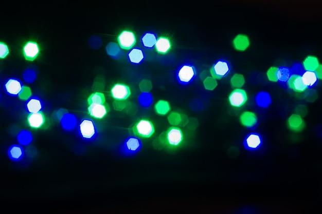 Streszczenie niewyraźne tło świecących żarówek