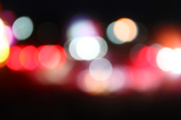 Streszczenie noc niewyraźne tło światła uliczne miasta bokeh. nieostry bokeh.