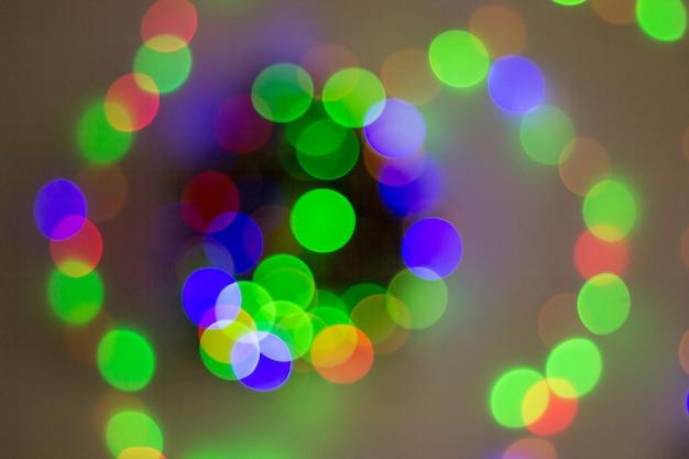 Streszczenie okrągły bokeh tło światła bożego narodzenia.