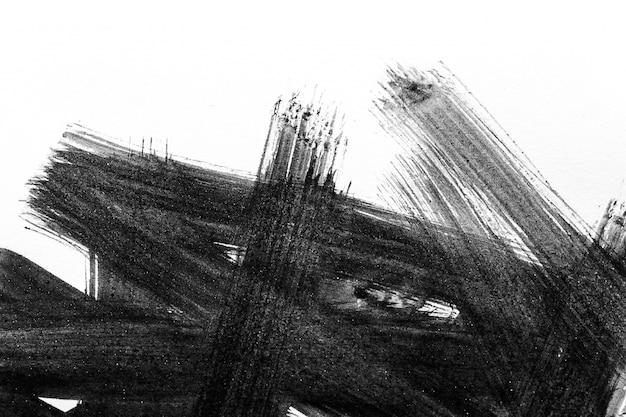 Streszczenie pędzla i plamy farby na białym papierze. akwarela tekstury do kreatywnych tapet lub prac projektowych, czarno-białe kolory.