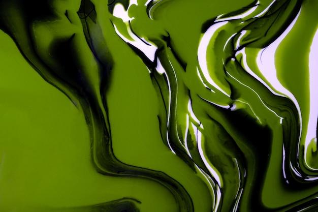 Streszczenie płynne kolory tła zielony, biały i czarny. płynny marmur. obraz akrylowy na płótnie z oliwkowym gradientem i pluskiem. atrament alkohol tło wzór fal.