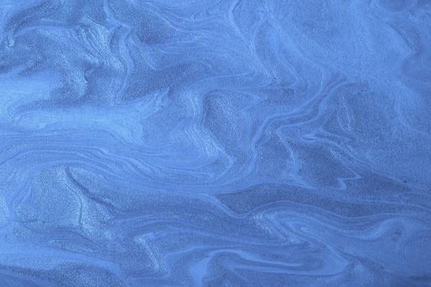 Streszczenie płynne tło granatowe kolory. płynny marmur. obraz akrylowy z błyszczącym szafirowym gradientem.