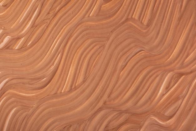 Streszczenie płynne tło sztuki w ciemnobrązowe kolory. płynny marmur. obraz akrylowy na płótnie z beżowym gradientem