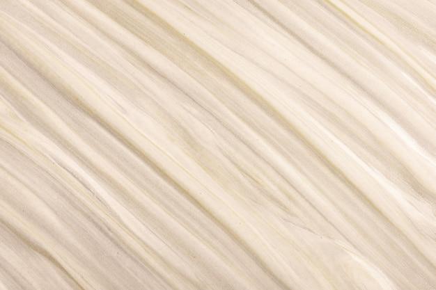 Streszczenie płynne tło w jasnych kolorach brązu i beżu.
