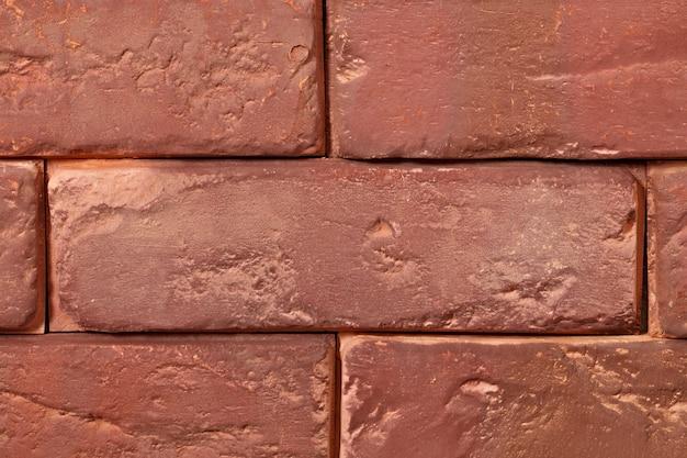 Streszczenie powierzchni starej czerwonej cegły.
