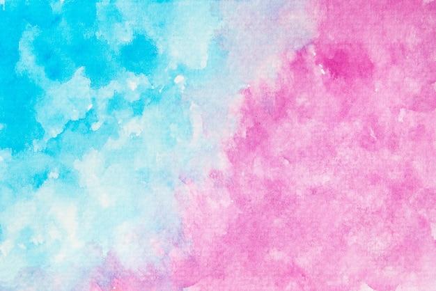 Streszczenie ręcznie malowane niebieskie i różowe tło akwarela tekstury