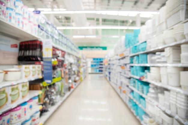 Streszczenie rozmycie centrum handlowego i sprzedaży detalicznej wnętrza sklepu na tle. niewyraźny supermarket