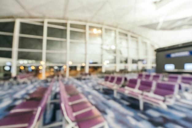 Streszczenie rozmycie i niewyraźne wnętrze terminalu lotniska