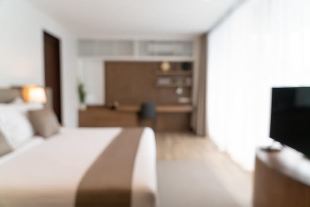 Streszczenie rozmycie piękne luksusowe wnętrze sypialni hotelu na tle