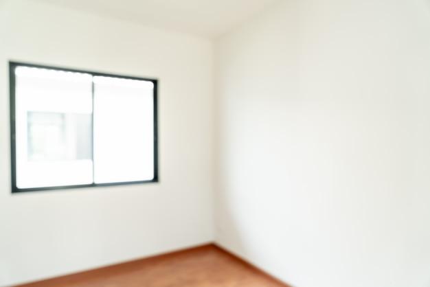 Streszczenie rozmycie pusty pokój z oknem i drzwiami w domu