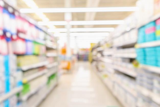 Streszczenie rozmycie supermarketu dyskont sklep nawy i półki produktów wnętrze nieostre tło