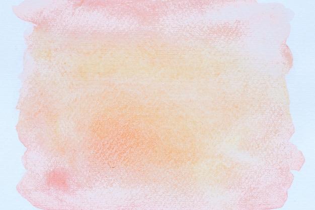 Streszczenie różowa akwarela na białym tle.