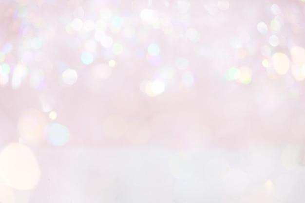 Streszczenie różowy pastelowy bokeh zaświeca tło.