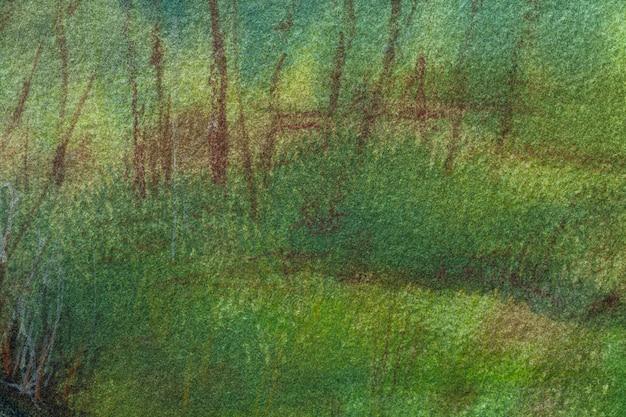 Streszczenie sztuka tło ciemnozielone i brązowe kolory. akwarela na płótnie z miękkim, oliwkowym gradientem. fragment grafiki na papierze z wzorem mchu. tekstura tło.