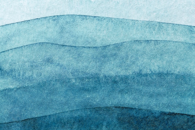 Streszczenie sztuka tło granatowe kolory. akwarela na płótnie z turkusowym wzorem morskich fal.