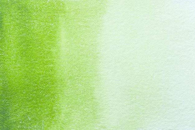 Streszczenie sztuka tło jasnozielone i oliwkowe kolory. akwarela na płótnie z gradientem.