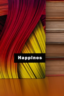 Streszczenie tęcza kolor taśmy fali papieru pionowe tło. streszczenie okładka notatnika. stos leżących książek.