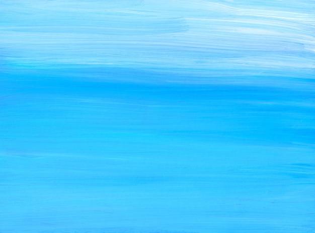 Streszczenie tekstura malarstwa tła. niebieskie i białe pociągnięcia pędzlem na papierze. piękny miękki cyjan artystyczny.