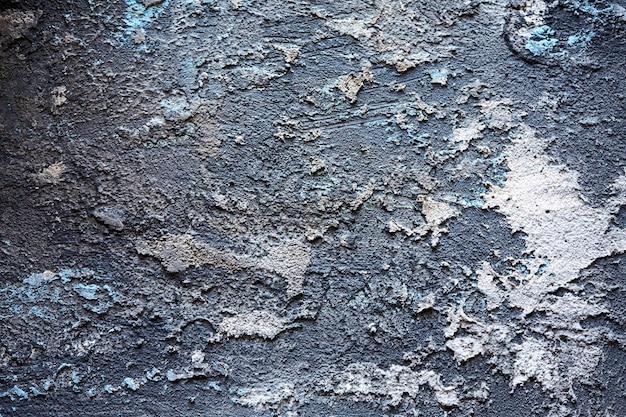 Streszczenie tekstura powierzchni pokrytej kitem. efekt ziarna i szumu. tło ściany pokryte kitem.