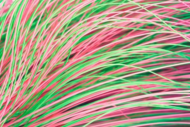 Streszczenie tekstura tło z kolorowymi cienkimi falistymi nitkami