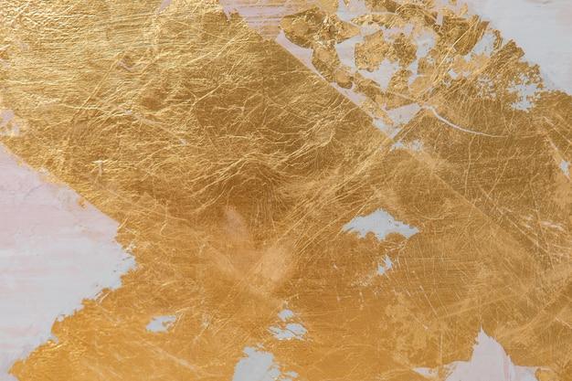 Streszczenie tekstura złota. dekoracyjne malowanie ścian w kolorze szarym i złotym tynkiem.