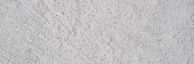 Streszczenie teksturowanej jasnoszarej powierzchni tekstury szorstkie tło, betonowa podłoga cementowa lub ściana.