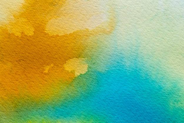Streszczenie tło akwarela żółty i niebieski