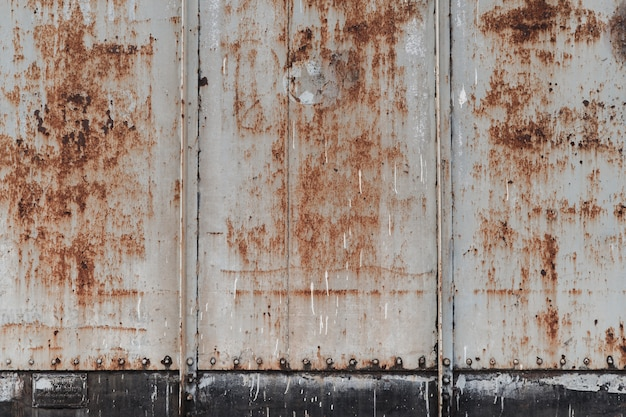 Streszczenie tło blachy stalowej z rdzy, ściany pociągu stary i zardzewiały