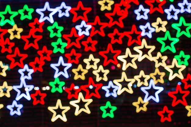 Streszczenie tło cyfrowe z obracającymi się neonowymi gwiazdami. nowoczesne widmo światła ultrafioletowego niebiesko-fioletowego