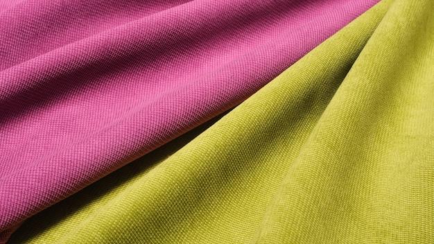 Streszczenie tło geometryczne aksamitnej tkaniny w kolorze różowym i zielonym