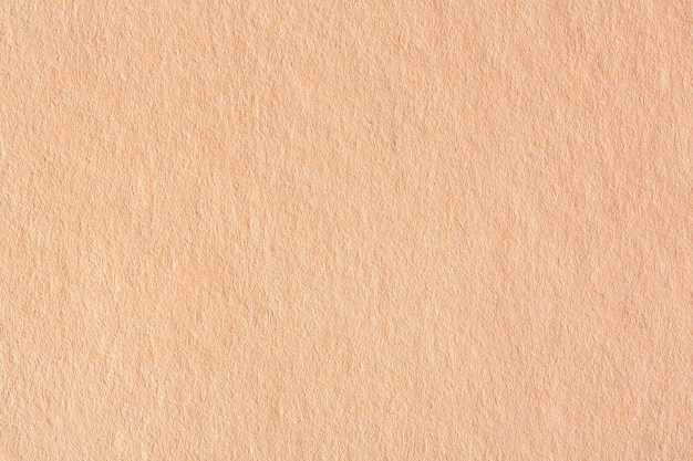 Streszczenie tło jasny brązowy papier. zdjęcie makro w wysokiej rozdzielczości.