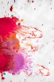 Streszczenie tło plam różowy, czerwony i bordowy