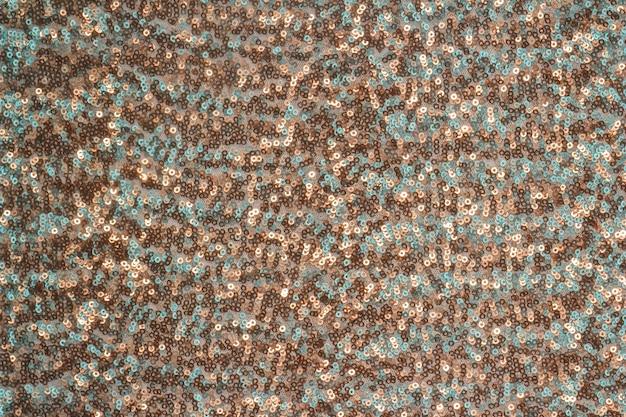Streszczenie tło uroczysty z okrągłymi cekinami z przejścia kolorów. kolory brązu i turkusu.