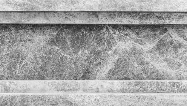 Streszczenie tło z ciemnej tekstury marmuru z grunge i podstaw
