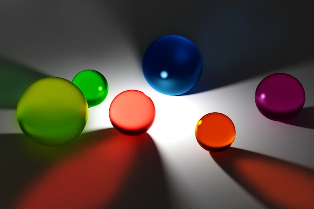 Streszczenie tło z różnych kolorowych wielobarwnych przezroczystych szklanych kulek na szaro. kreatywny layout produktów ekspozycyjnych. kopiowanie przestrzeni, renderowanie 3d