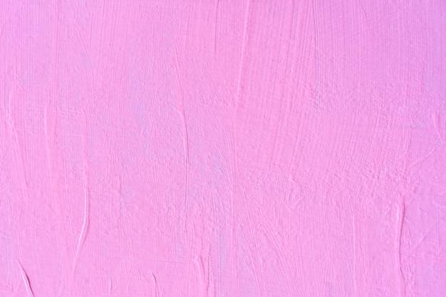 Streszczenie tło z różowym malowane na ścianie.