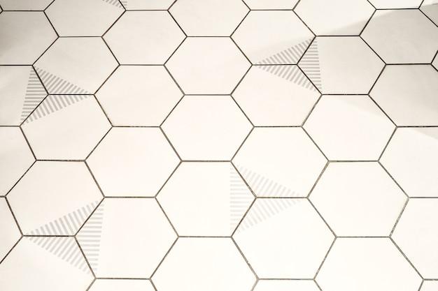 Streszczenie tło z siatką komórek w kształcie sześciokąta na białym tle