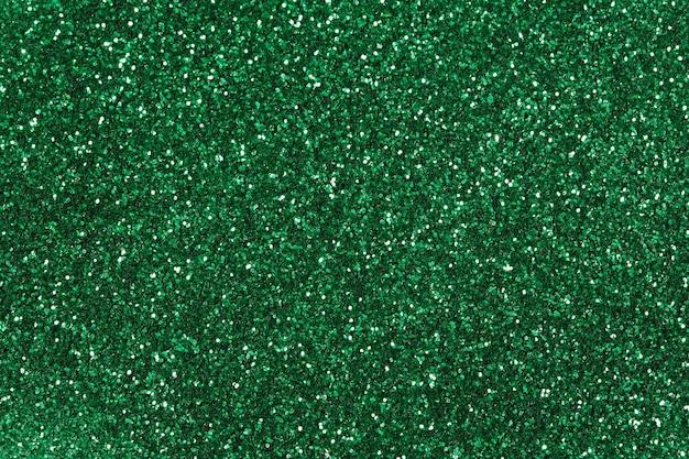 Streszczenie tło zielony brokat zbliżenie. fotografia makro.