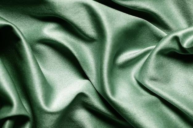 Streszczenie tło zielony włókienniczych. ścieśniać