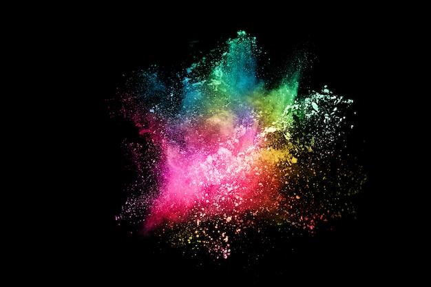 Streszczenie wybuchu pyłu kolorowe na czarnym.