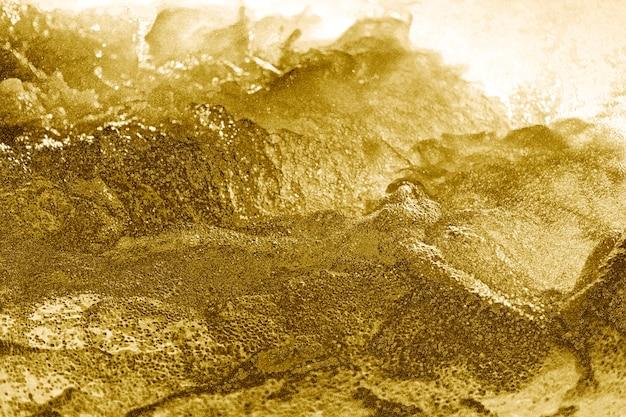 Streszczenie złote wyboiste teksturowane tło