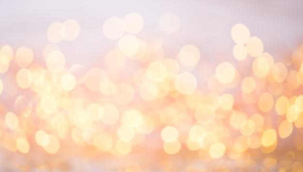 Streszczenie złoty bokeh. boże narodzenie i nowy rok motyw tła.