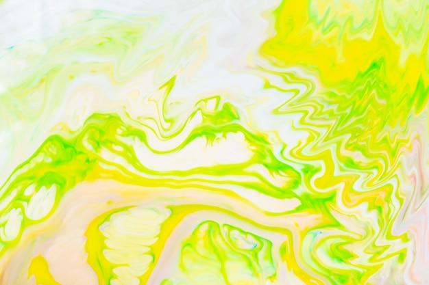 Streszczenie żółto-zielone tło płynne. zielony wzór farby z cyklicznymi zawijasami. modna tapeta. koncepcja ekologiczna