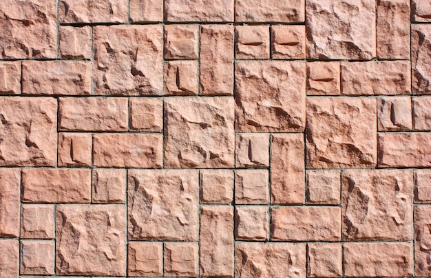 Struktura betonowej i kamiennej ściany z rysunkiem i różnymi kolorami